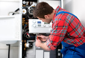 a peter stannard plumber servicing a hot water system